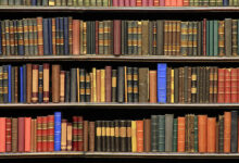 1 old books on a library luoman